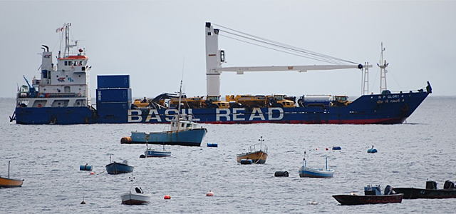The Basil Read ship at anchor, with local boats in the foreground of the picture