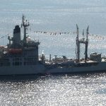May: RFA Black Rover with bunting for St Helena's Day, by Neil George