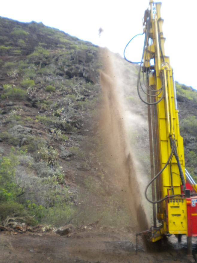 Water spurts from a new bore hole