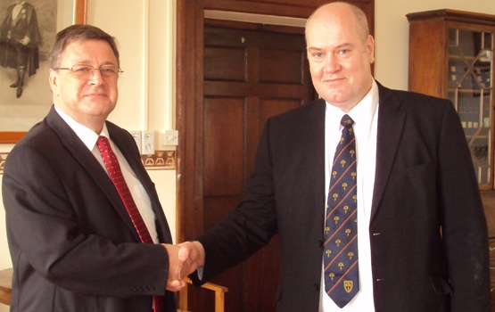 John MacRitchie shakes hands with Governor Capes