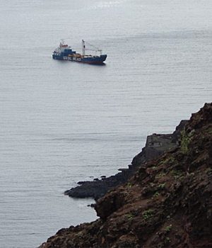 The NP Glory 4 turns into James Bay, dwarfed by the scale of cliffs