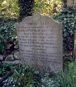 Samuel Ally's gravestone with a lot of script engraved on it.